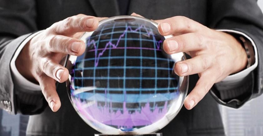 mãos masculinas seguram uma bola de cristal com um gráfico refletido dentro dela